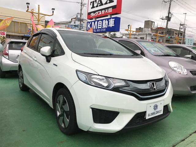 沖縄の中古車 ホンダ フィットハイブリッド 車両価格 92万円 リ済込 2015(平成27)年 6.6万km パールホワイト