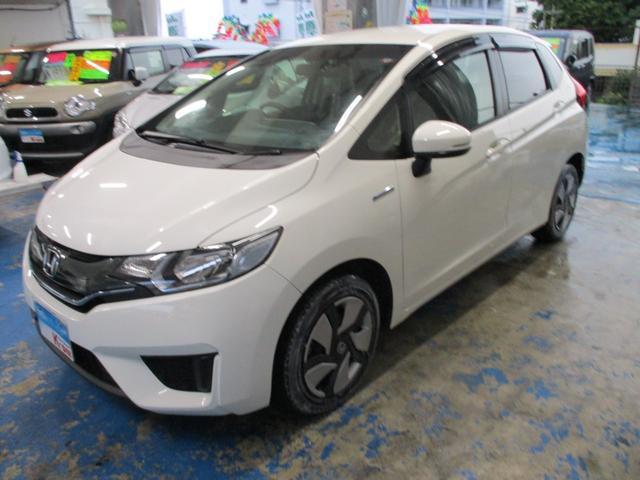 沖縄の中古車 ホンダ フィットハイブリッド 車両価格 69万円 リ済込 2015(平成27)年 6.7万km ホワイト