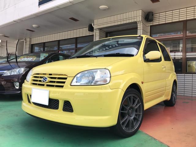 沖縄の中古車 スズキ スイフト 車両価格 39万円 リ済別 2004(平成16)年 9.5万km ブリリアントイエロー