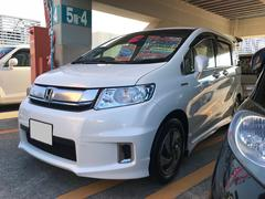 沖縄の中古車 ホンダ フリードスパイクハイブリッド 車両価格 119万円 リ済込 平成28年 9.2万K パールホワイト