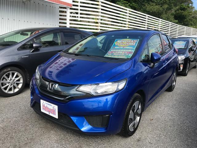 沖縄の中古車 ホンダ フィットハイブリッド 車両価格 88万円 リ済込 2015(平成27)年 8.4万km ブルー