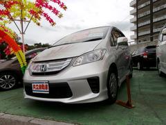 沖縄の中古車 ホンダ フリードハイブリッド 車両価格 118万円 リ済込 平成24年 9.7万K シルバー