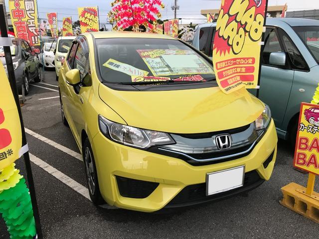 沖縄の中古車 ホンダ フィットハイブリッド 車両価格 79万円 リ済込 2013(平成25)年 7.8万km イエロー