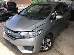 沖縄の中古車 ホンダ フィットハイブリッド 車両価格 119万円 リ済込 平成25年 3.3万K グレー