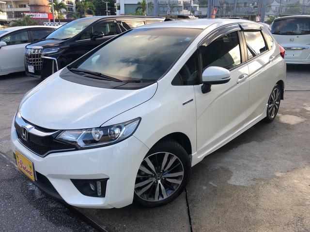 沖縄の中古車 ホンダ フィットハイブリッド 車両価格 114万円 リ済込 2015(平成27)年 8.4万km パール