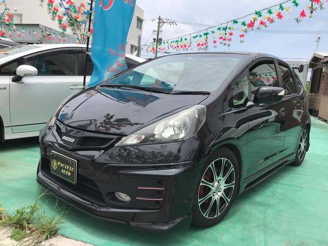 沖縄の中古車 ホンダ フィット 車両価格 89万円 リ済込 2011(平成23)年 7.6万km ブラック