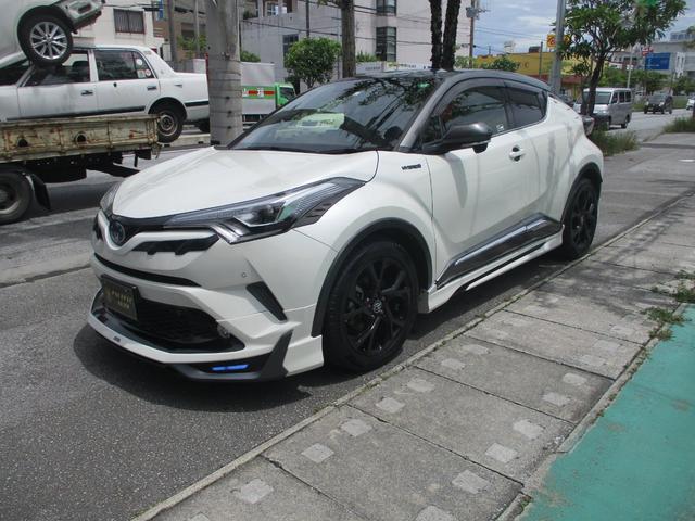 沖縄県の中古車ならC-HR G ハイブリッド アイドリングストップ 9インチSDナビ OP18インチアルミ モデリスタフルエアロ