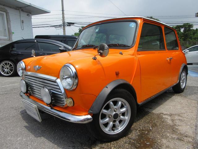 沖縄県の中古車ならローバー MINI クーパー1.3オールペイント シートカバー