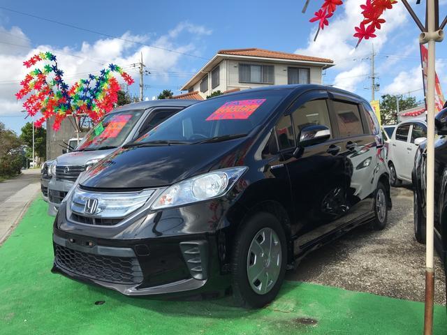 沖縄県うるま市の中古車ならフリードハイブリッド ハイブリッド TVナビ パワースライドドア キーレス