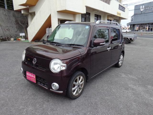 沖縄の中古車 ダイハツ ミラココア 車両価格 38万円 リ済込 平成23年 8.6万km ブラウン