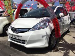 沖縄の中古車 ホンダ フィットハイブリッド 車両価格 75万円 リ済込 平成25年 8.9万K タフタホワイト