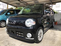 沖縄の中古車 ダイハツ ミラココア 車両価格 49万円 リ済込 平成21年 9.0万K ブラックマイカメタリック