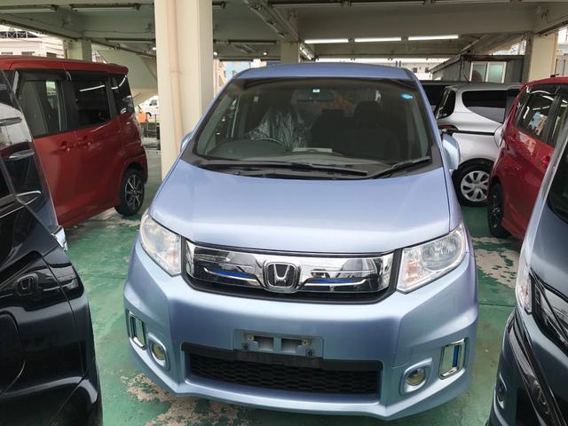 沖縄の中古車 ホンダ フリードスパイクハイブリッド 車両価格 129万円 リ済込 平成26年 7.7万km ライトブルー