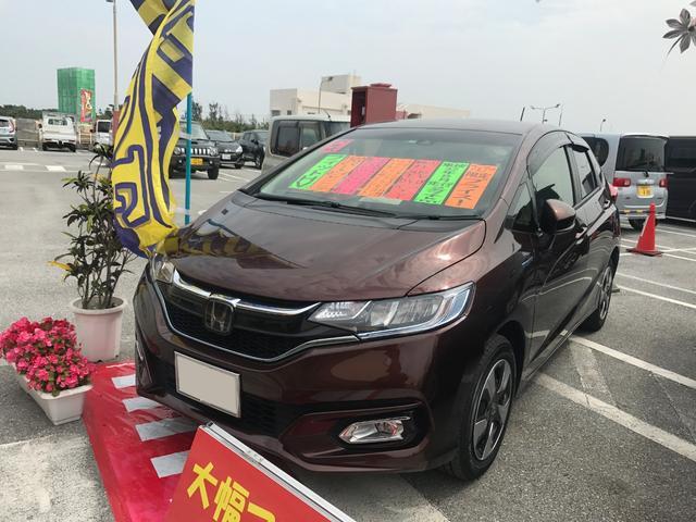沖縄の中古車 ホンダ フィットハイブリッド 車両価格 146万円 リ済込 平成29年 2.7万km ブラウン