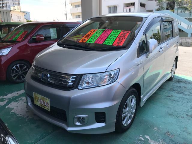 沖縄の中古車 ホンダ フリードスパイクハイブリッド 車両価格 69万円 リ済込 2012(平成24)年 9.6万km シルバー
