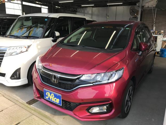 沖縄の中古車 ホンダ フィットハイブリッド 車両価格 129万円 リ済込 2018(平成30)年 2.0万km ワイン