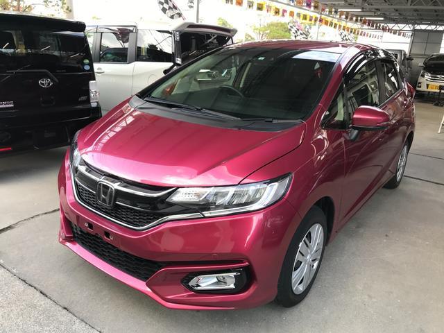沖縄の中古車 ホンダ フィット 車両価格 113万円 リ済込 2018(平成30)年 2.3万km ワイン