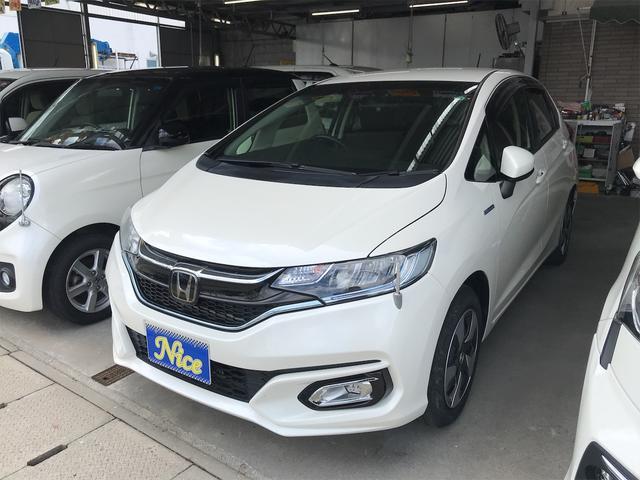 沖縄の中古車 ホンダ フィットハイブリッド 車両価格 115万円 リ済込 2017(平成29)年 1.4万km パールホワイト