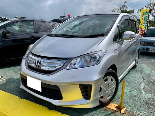 沖縄県の中古車ならフリードハイブリッド ジャストセレクション 両側パワースライドドア ETC 2列目ベンチシート 7人乗り スマートキーシステム オートエアコン クルーズコントロール