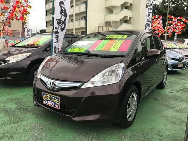 沖縄の中古車 ホンダ フィットハイブリッド 車両価格 79万円 リ済別 平成24年 1.3万km プレミアムディープモカパール