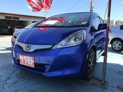 沖縄の中古車 ホンダ フィットハイブリッド 車両価格 66万円 リ済込 平成23年 9.0万K アズールブルーメタリック