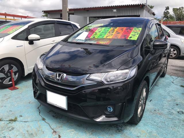 沖縄県の中古車ならフィットハイブリッド Fパッケージ ナビ バックカメラ スマートキー AW