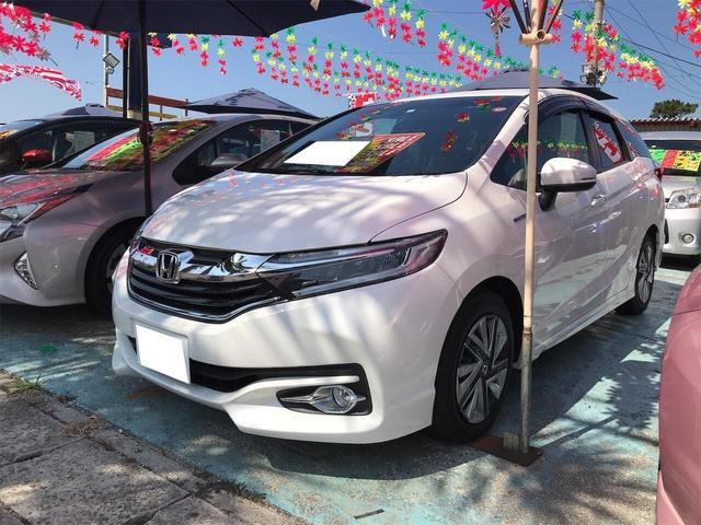 沖縄の中古車 ホンダ シャトル 車両価格 158万円 リ済込 2016(平成28)年 4.0万km ホワイトオーキッドパール