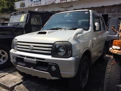 沖縄の中古車 スズキ ジムニー 車両価格 9.8万円 リ済込 平成14年 12.0万K スペリアホワイト