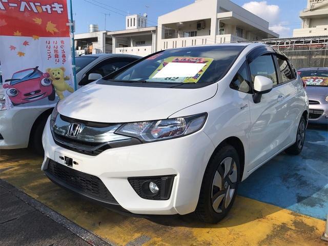 沖縄県の中古車ならフィットハイブリッド Fパッケージ スマートキ Bモニター アイドリングストップ