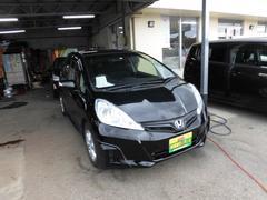 沖縄の中古車 ホンダ フィットハイブリッド 車両価格 65万円 リ済込 平成24年 7.3万K ブラック