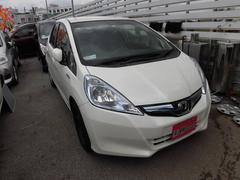 沖縄の中古車 ホンダ フィットハイブリッド 車両価格 59万円 リ済込 平成24年 5.8万K パール