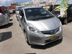 沖縄の中古車 ホンダ フィットハイブリッド 車両価格 59万円 リ済込 平成24年 7.1万K シルバー