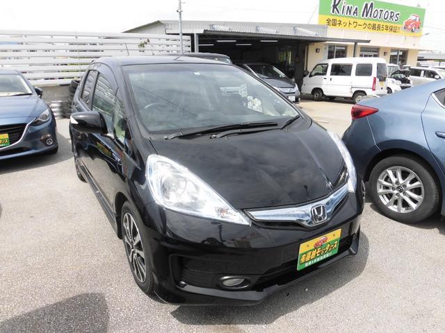 沖縄の中古車 ホンダ フィットハイブリッド 車両価格 78万円 リ済込 平成25年 7.0万km ブラック