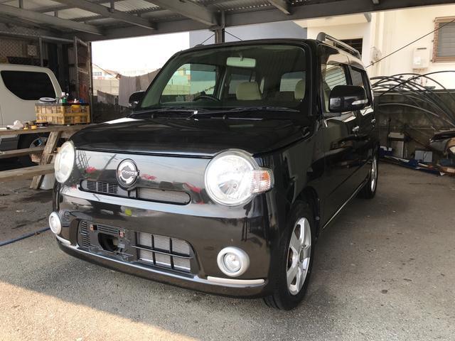 沖縄の中古車 ダイハツ ミラココア 車両価格 33万円 リ済込 2010(平成22)年 8.0万km ブラック