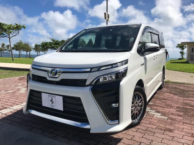 うるま市 (株)Body Shop China トヨタ ヴォクシー ハイブリッドZS トヨタセーフティS 9型ナビ 後席M ホワイトM 0.5万km 2017(平成29)後