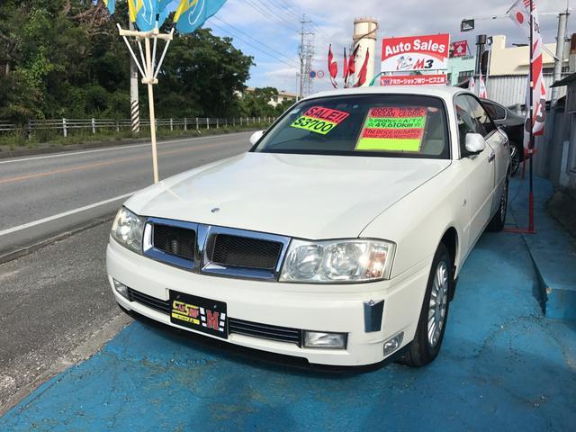 沖縄の中古車 日産 セドリック 車両価格 29万円 リ済別 平成15年 5.0万km ホワイトパール
