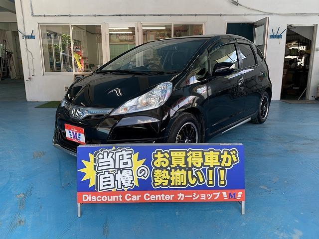 沖縄の中古車 ホンダ フィットハイブリッド 車両価格 69万円 リ済込 2013(平成25)年 6.2万km ブラックM