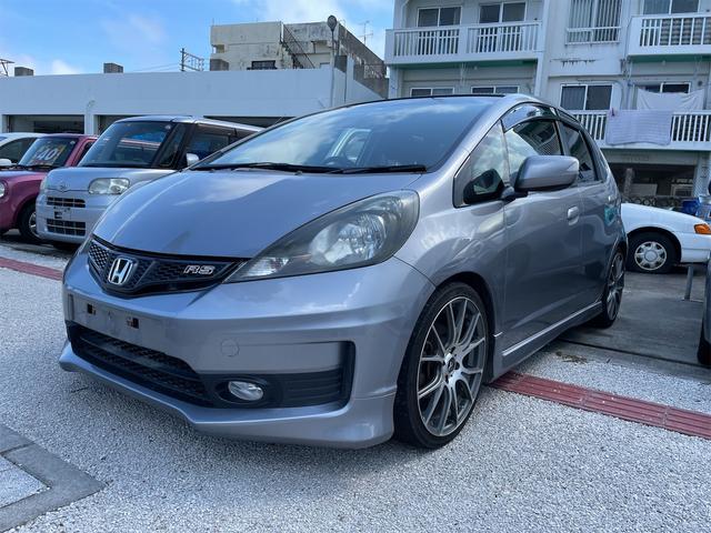 沖縄の中古車 ホンダ フィット 車両価格 38万円 リ済込 2011(平成23)年 13.2万km シルバー