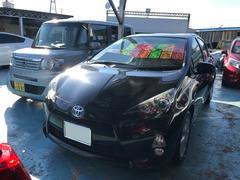 沖縄の中古車 トヨタ アクア 車両価格 104万円 リ済別 平成24年 7.3万K ブラックマイカ
