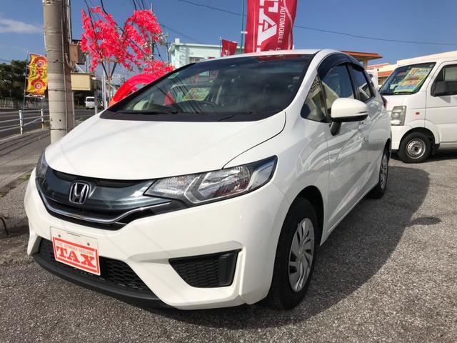 沖縄の中古車 ホンダ フィット 車両価格 79万円 リ済込 2013(平成25)年 7.3万km ホワイト