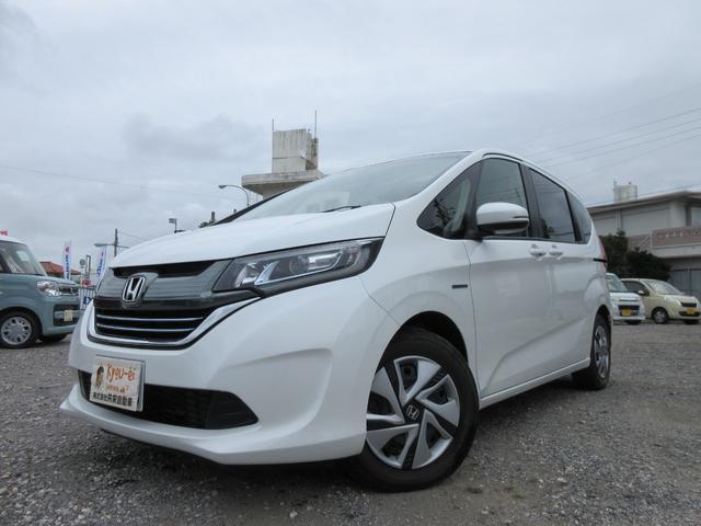 沖縄の中古車 ホンダ フリードハイブリッド 車両価格 235万円 リ済込 平成29年 0.5万km パールホワイト