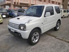 沖縄の中古車 スズキ ジムニー 車両価格 49万円 リ済込 平成16年 12.2万K ホワイト