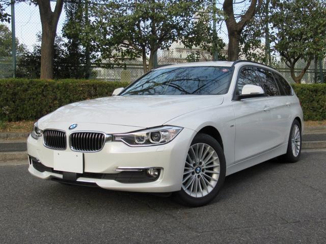 BMW 3シリーズ 320dツーリング ラグジュアリー パールホワイト ACCアダプティブクルーズ インテリジェントセーフティ オートテールゲート 黒革シート シートヒーター パワーシート コンフォートアクセス HDDナビ Bカメラ PDC ETC 禁煙車