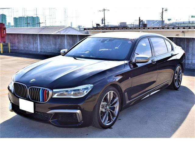 BMW 7シリーズ M760Li xDrive アンビエントエアパッケージ・エグゼクティブラウンジシート・パノラマスライディングルーフ・フルセグ・リヤエンター・マッサージ機能有・全方位カメラ・ディスプレイキー有・HUD・純正20AW・ブラウンレザー