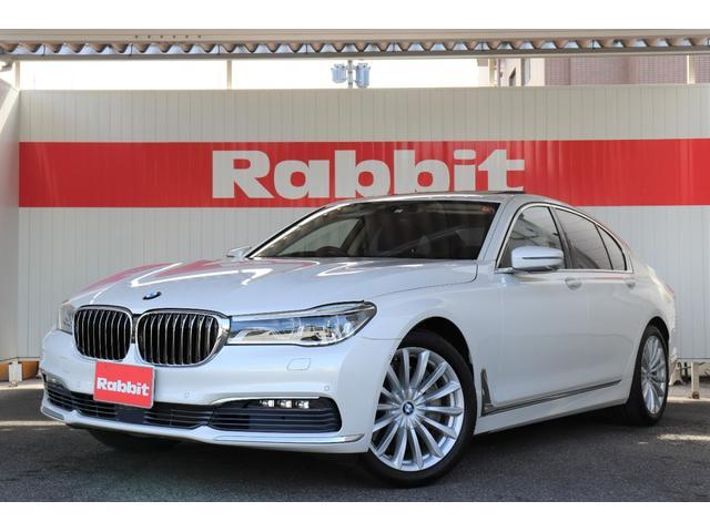 BMW 750i 禁煙1オーナー/フルセグナビ/360カメラ/インテリジェントセーフティ/黒革電動シート/OPマッサージシート/OPリモートパーキング・ディスプレイキー/OPサンルーフ/イレーザーライト/パワートランク