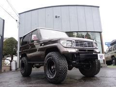 ランドクルーザープラドSXワイド 4WD サンルーフ ハイリフト 社外バンパー