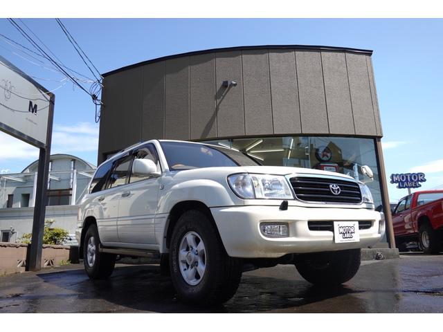 トヨタ ランドクルーザー100 VXリミテッド 寒冷地仕様車 マルチレス 背面レス ジオランダーA/Tタイヤ 純正ウッドステアリング ウッドATシフト ウッドコンソールパネル