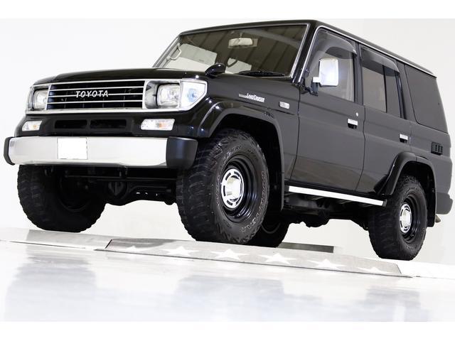 SXワイド 4WD タイベル交換済 黒レザー調シートカバー(1枚目)