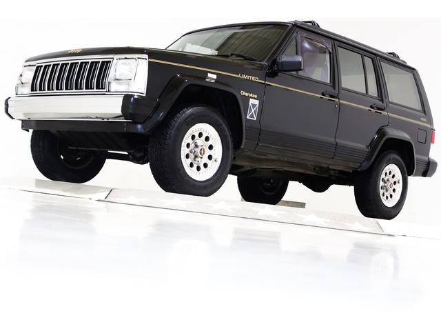 クライスラー・ジープ ジープ・チェロキー リミテッド 4WD 内装ベージュ 本革電動シート キーレス ディーラー車 右ハンドル クリスタルヘッドライト クリアコンビテールランプ フロントクロームメッキバンパー リアクロームメッキバンパー 背面レス車