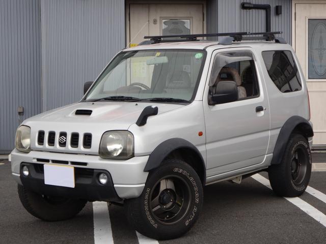 スズキ ジムニー XC オーバーフェンダー 社外マフラー WILD BOAR 15インチアルミホイール YOKOHAMA GEOLANDAR A/T.Sホワイトレタータイヤ(225・70R15)